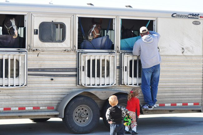 On the road with kids and horses.