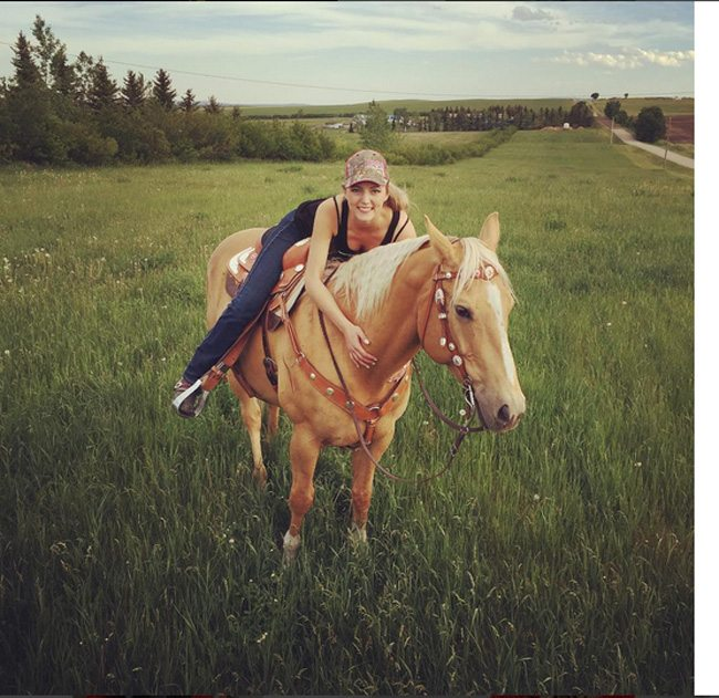 Maggie on her Stampede horse, Kansas.