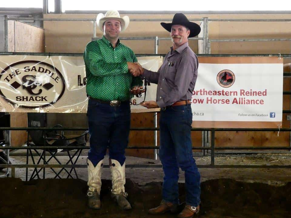 9591f0f9c69c8 Darren Bilyea receiving a Greg Darnell bit for his High Point Award.  Presented by Steve Close of The Saddle Shack